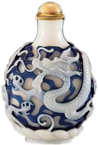 Glass with double overlays of milky white and transparent sapphire-blue colors on white glass carved with a continuous design of two four-clawed dragons, 1760–1790. Bloch Collection.