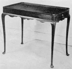 A New England Tea Table: Made of mahogany, with its molded top, clover leaf corners, slender cabriole legs and Dutch feet, this is a very graceful design delicately executed.