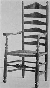 A Pennsylvania Chair: The lack of turnings between the slats of the back, the boldly turned front stretcher, the shaping of the arms, and cresting of the slats are typical of 18th-Century chairs made in that colony and some parts of New Jersey.