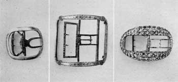 As Jewelry, Buckles Were Important: No man was well dressed without them. Left to right, those illustrated are plain silver knee buckle, marked fl B in oval, possibly by Adrian Banker, New York silversmith, 1703-72; center, large bright-cut steel shoe buckle, probably imported from England; right, stock buckle set with paste brilliants. This one belonged to Governor Jonathan Trumbull of Connecticut, 1704-1806.
