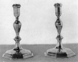 Candlesticks by John Burt: These were given to Nicholas Sever by his students in 1724 and presented to Harvard many years ago by a descendent.