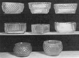 Illustration I: Eight Molded Salt Dishes: These were made prior to the advent of blown three-mold glass. They were produced at the New England Glass Company, Cambridge, Massachusetts, after 1818, and at the Boston & Sandwich Glass Company after 1825.