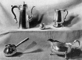 English Silver Owned in Virginia: Top row, left to right: Coffeepot, Joseph Smith, London, 1732; hunting cup given by Charles II to Sir William Temple, circa 1661; can, London, 1769, engraved with crest of John Randolph of Roanoke. Bottom row: Brandy warmer, probably by James Geddy, Williamsburg; gravy boat, London, 1718, originally owned by Nathaniel Harrison of Brandon.
