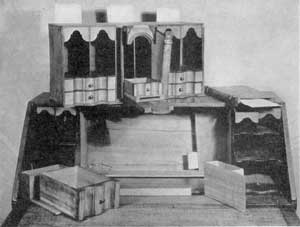 ILLUSTRATION IV: Fifteen Secret Places: This is the interior of the New England Queen Anne desk illustrated on the cover. The central section has been removed to show the pocket concealed at the back. In the foreground are two of the secret drawers. At the back can be seen an additional document box that slides behind the pigeonholes on that side. Beneath the central section can be seen the well that occupies the space of the large false drawer. Access is through the sliding panel built into the writing surface, which has been pushed back.