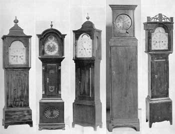 Five Characteristic American Grandmother Clocks: From left to right the makers and height are Reuben Tower, Hingham, Mass., 46 inches; Valin, Quebec, 48 inches; Joshua Wilder, Hingham, Mass., 46 inches; probably by Simon Willard, Roxbury, Mass., 46 inches; and Levi Hutchins, Concord, N. H., 45 inches.