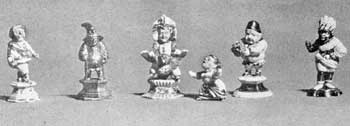Illustration IX: A Group of Callot Figures: Made 1712 to 1719 and unmarked, some were decorated with gold foil attached with lacquer; others with fired gold. Average height, three and one-half inches.