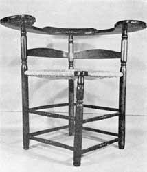 Illustration V: A chair of over-size proportions and simple detail. The wide sweep of the pine arms, thirty-six inches across, with almost circular ends suggest it may have been designed for use in a tavern taproom.