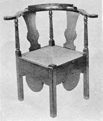 Illustration VI: Of maple in Queen Anne style, circa 1720-1740. The front cabriole leg terminating in a Dutch foot and turned diagonal stretchers are the outstanding features of this chair.