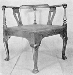 Illustration VIII: A remarkably large chair. Made about 1720, it has four cabriole legs terminating in Spanish feet and no cross stretchers, which is most unusual in American chairs of this type.