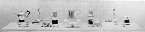 Made for Nicholas Sever, Harvard Tutor: All were the work of John Burt except for the cann altered into a pitcher, at the center right; that was the work of W. Simpkins. These pieces date from 1715 to 1728.