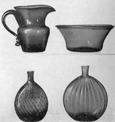 Illustration VI: Other Examples, Probably Ohio Glass: Top row, left, a large free-blown pitcher, not patterned, in dark amber glass attributed to Zanesville; right, bowl of golden amber glass, not patterned. Lower row, left, chestnut flask with broken swirl in deep amber glass; and right, grandfather flask in clear glass with expanded ribbing.