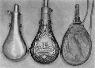 Plate IV – Three Contrasting Types: Left, the earliest type, no decoration or maker's mark; center, a sportsman's flask with central scene showing an Indian buffalo hunting; right a homemade shot pouch of leather with horn nipple and cap. Shot carried in a metal flask might rattle and warn the game being hunted.