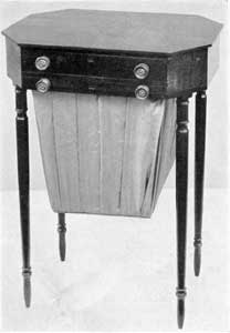 Salem Sewing Table, Circa 1800: It shows strongly the Sheraton influence and, although unlabeled, is considered to be by Nathaniel Appleton.
