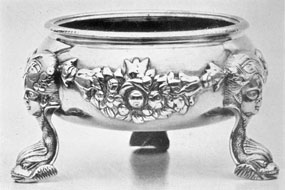 Salt Dish in the Rococo Style: One of a pair made about 1740 by Charles Le Roux, son of Bartholomew Le Roux. It is among the most elaborately decorated pieces of silver of this style made in New York. Their maker worked circa 1724-1745.