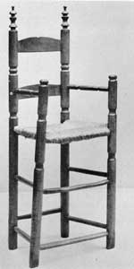 Slat-Back High Chair: Made late in the 17th Century, the finials, ring turnings, and buttons on the front legs characterized many American chairs made until early in the 18th Century.