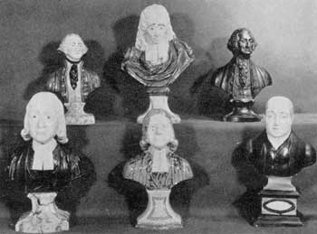 "Typical Staffordshire Portrait Busts: They are, top row, left to right: an unmarked Washington; John Milton, by Ra. Wood; and George Washington, by Enoch Wood, date, 1818. Bottom row, left to right: W. M. Cloves, a Methodist preacher, marked ""B S & T, Burslem""; John Wesley, by Ra. Wood; and John Wesley, by Enoch Wood."