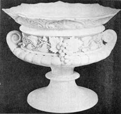 2. One of a pair of classic urn-shaped vase in English Parian ware, c. 1840. The applied relief of grapes and leaves is on a band of blue.