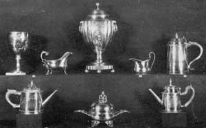 Virginia Silver of American Make: Left to right, top row: 18-Century stirrup cup — engraved, John Gilchrist to Philip Barraud — as inherited in the Cocke family; Paul Revere gravy boat; coffee urn by Christian Wiltberger, Philadelphia, 1770-1851, from Westover; Curtis family cream pitcher by Adam Lynn, Alexandria, 1796; tankard by R. Greene, Boston, 1707-1777, also from the Cocke family. Bottom row, left to right: Teapot, Joseph Anthony, Philadelphia, 1783-1814; covered butter dish, Paul Revere; teapot, also by Revere, Boston, 1735-1818.