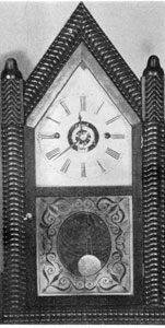 1. Gothic-style (steeple) clock of the third period (1842-49), bearing on the label the name combination of Forestville Manufacturing Company and J. C. Brown.