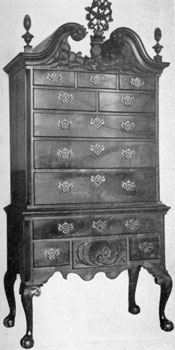 2. Highboy with a bonnet or enclosed pitch scroll top. Note the combination of uncarved, scalloped skirt and finely carved knees, cartouche, finials, etc.