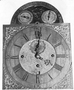 "5. Dial and view of the works of a 30-day musical clock engraved on dial, ""William Faris Annapolis."""