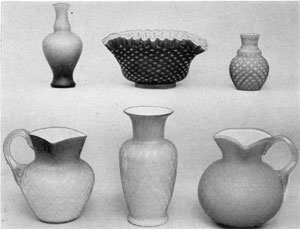 9. Group of Satin glass illustrating the many patterns and colors obtainable by using varied colors and platings. Vase at upper left shades from blue to pink; the bowl next to it is purple; the small vase, pink. The lower left pitcher shades from white to deep rose; the vase next it, ivory to pink; the right-hand pitcher is deep blue.