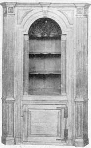 American Chippendale Corner Cupboard: Made of pine about 1765, this piece has a very fine shell carved dome, nicely shaped shelves, finely executed moldings, and reeded pilasters. It was an architectural piece of furniture of the period and probably was built into the corner of the room for which it was designed.