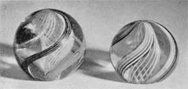 Antique Swirled Glass Marbles: With these the bases were flattened so that they became miniature paperweights.