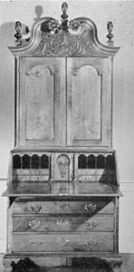 A Carved Walnut Secretary: It was made in Philadelphia circa 1760 for a Lancaster County, Pennsylvania, family. In form and ornamental carving, particularly of the front of the bonnet top, the quarter-round pilasters of both upper and lower sections and the carved shell door of the interior are all representative of the finest Philadelphia craftsmanship.