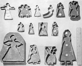 Illustration II: Cooky Cutters Depicting Women and Children: From the simple outline at the upper left to the more detailed one at the lower right, these fourteen cutters show the development of the outlines of such designs.