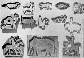Illustration III: Cutters With Animal Silhouettes: Here, at the upper left, is a traditional design. In the lower row, flanking an elephant, two men on horseback show the gradual development of such animal designs.