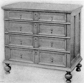 Early William and Mary Example: Made in New England circa 1690-1700. Although the wood is still oak, the absence of carving, use of moldings, arrangement of four drawers, each slightly deeper than the one above, and the turned bulbous feet are all characteristic of the William and Mary period in American furniture.