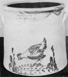 An Unusual Stone Crock: Made by Adam Caire of Poughkeepsie, New York, in the last quarter of the 19th Century. Its distinctive feature is the decoration in cobalt blue of a chicken pecking at corn.