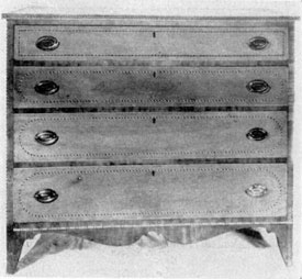 A Hepplewhite Chest of Drawers: The consistent use of two-color bands and ovals of inlay, the French foot and shaped apron beneath the lower drawer, show how widely the Hepplewhite style was followed.