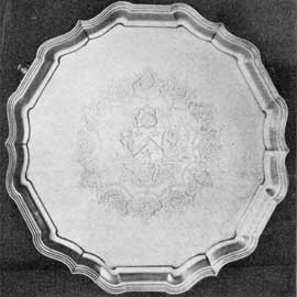 4. Another example of the way Augustine Courtauld gained distinguished simplicity by leaving much of his silver surface plain. Vigorously shaped salver dating from 1730-31. Engraved with the arms of Blackett.