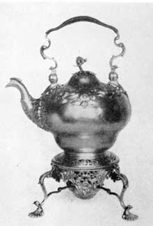 6. Pyriform tea kettle and stand with subdued rococo decorations of flowers and scrolls. By Samuel Courtauld, Sr. Dating 1755-56.