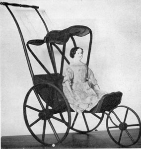 A Jenny Lind Doll: This is known to have been a gift in 1866. It has a German china head with blue eyes and black hair. The body is of kid. This doll is seated in a Joel Ellis doll carriage of the same period.