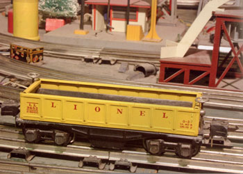 The Lionel No. 3652 Barrel-Dumping Gondola had swing-up sides that were actuated by remote control.