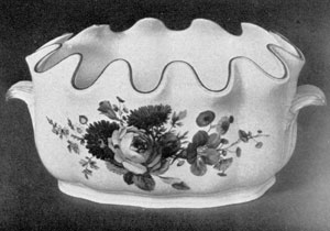 Marcolini Meissen Montieth: This piece, oval in shape and decorated with large flower groups done in naturalistic colorings, was made late in the 18th Century.