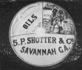Millville Commercial Product: This paperweight, used for advertising by S. P. Shotter el Co., Savannah, Georgia, dealers in oils and turpentine, is of the picture type made at Millville. In the upper right-hand corner can be seen a typical scene at a Georgia turpentine distillery.