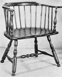 A Philadelphia Low-Back Windsor: This chair with characteristic blunt-arrow turned legs and shaping of the seat, dates between 1750 and 1770.
