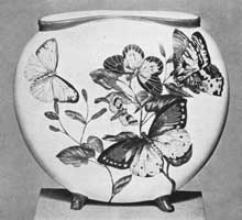 Illustration I: Rookwood Vase Dated 1882: Butterflies are the motif of this hand-painted piece. It is of the period when the fashion in Cincinnati was to decorate individual pieces made at the pottery.
