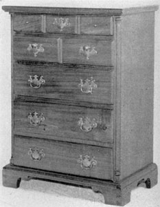 Tall Chippendale Chest of Drawers: Made of walnut and unornamented except for applied half-round columns at front corners and the over lapping molding of edge of drawer fronts, this is a plain piece of small size. Probably made in Pennsylvania about 1760-70 by a village cabinetmaker.