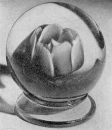 Three Desirable Antique Paperweights II: A Millville rose, an example of the work of Ralph Barber, who made some of the most artistically beautiful and distinctive weights of American origin.