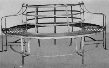 An 18th-Century Tree Seat: It was made in two parts to surround the trunk. This is a piece that was developed in England. The decoration was achieved by reeding and the use of well-shaped paw feet.