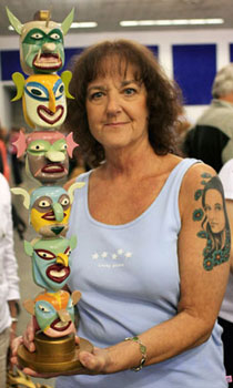 A guest shows us her ceramic totem pole while waiting for an appraiser. Although only one side is pictures, the totem features unique and colorful faces on both sides.