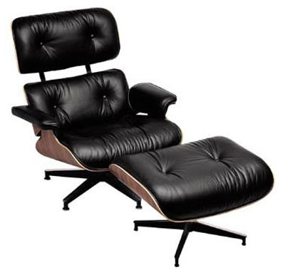 A Ray and Charles Eames walnut and leather 670/671 lounge chair and ottoman.