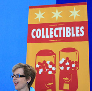 Kathleen Guzman stands at the Collectibles table, where she lent her experience as an appraiser and auctioneer to determine the history and value of various items.