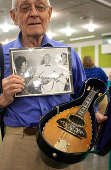 Carmine and his Vinaccia mandolin from Naples, Italy bought by his father 101 years ago.