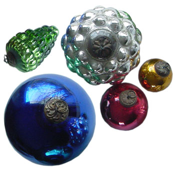 Kugels glass Christmas ornaments that are made using colored glass and then silvered on the inside.